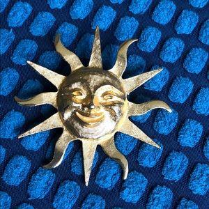 Sun brooch
